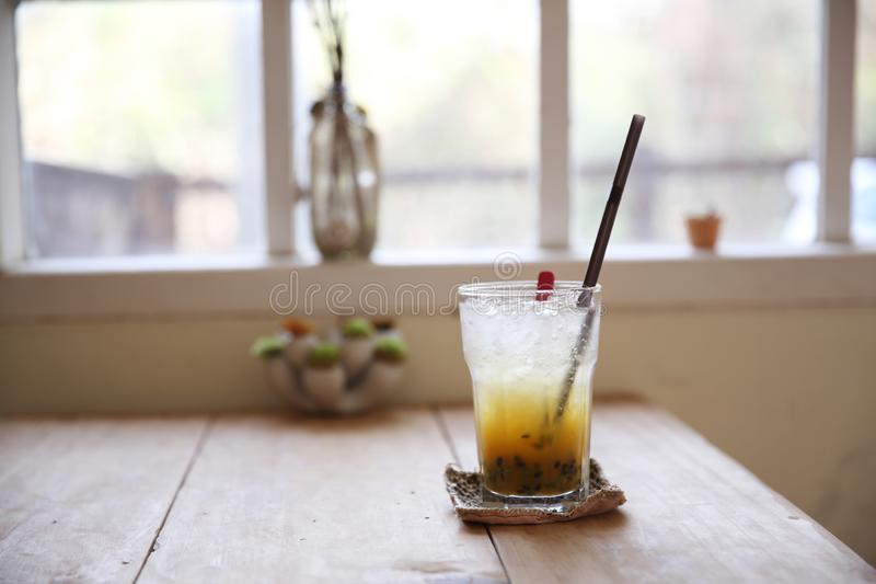 Passion fruit juice. On wooden table stock photos
