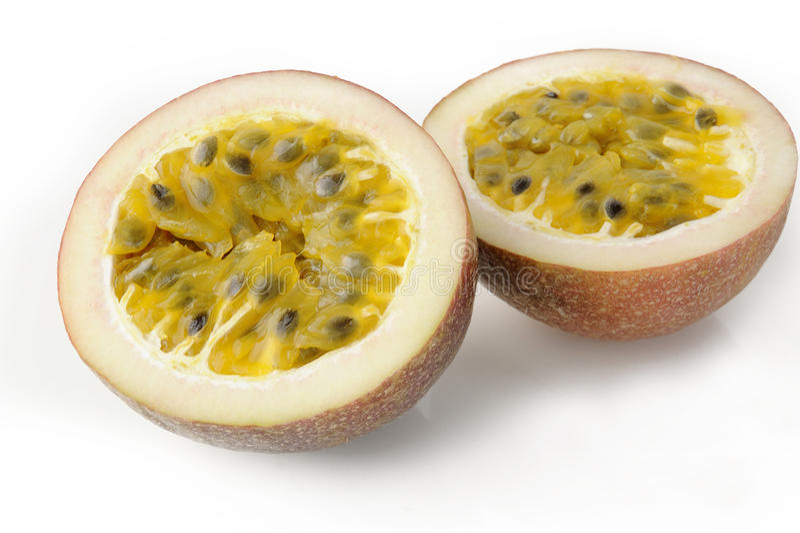 Passionfruit på vit bakgrund royaltyfria foton