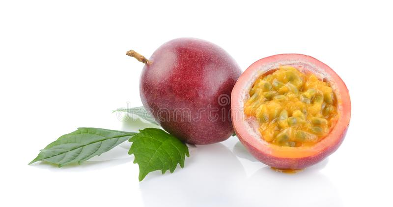 Passionfruits with green leaves isolated on white background royalty free stock images