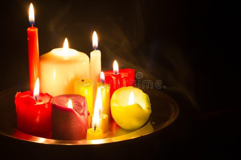Passomen och magisk abstrakt bakgrund med stearinljus i natt royaltyfri fotografi