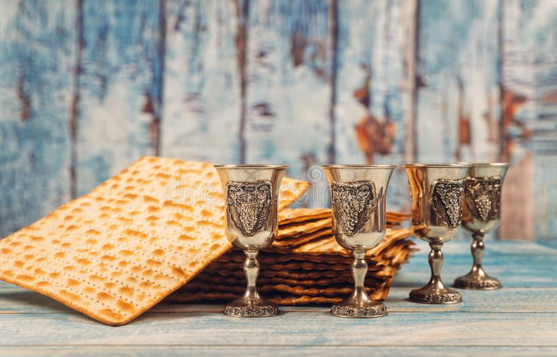 Passover background four glasses wine and matzoh jewish holiday bread over wooden board stock photos