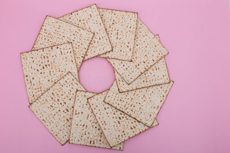 Passover background Matzah mandala design flat lay pink pesach Jewish holiday Nisan royalty free stock photos