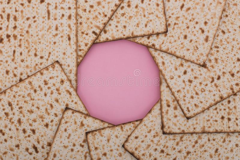 Passover background Matzah mandala design flat lay pink pesach Jewish holiday Nisan. Passover background pesach mandala Matzah pink background design flat lay stock image