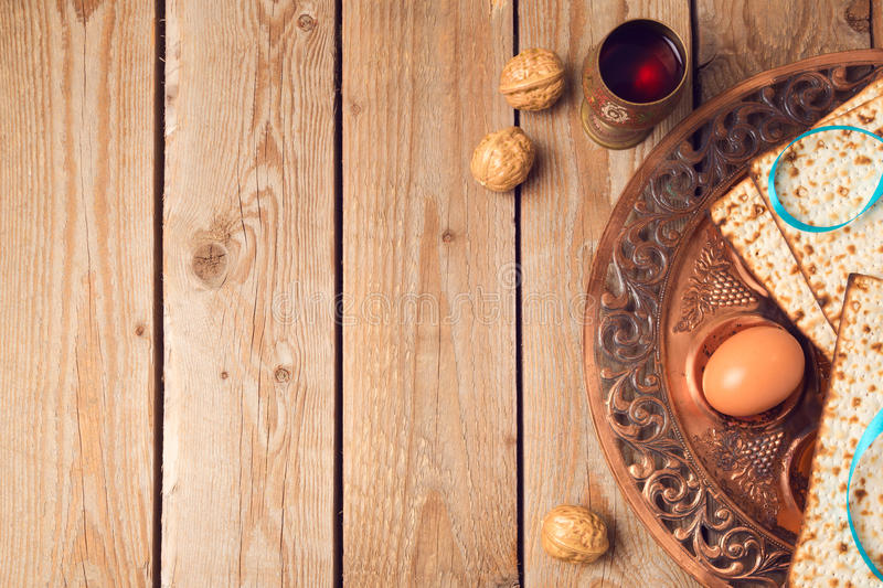 Passover concept with matzah, seder plate and wine on wooden background. View from above royalty free stock image