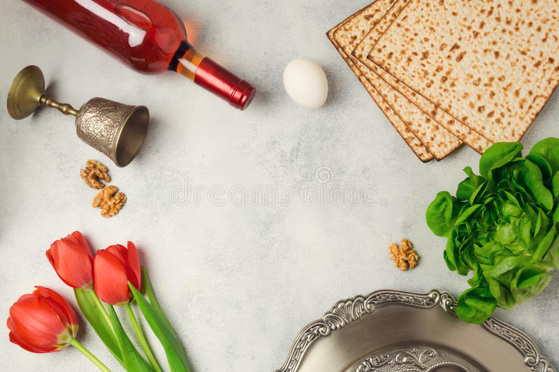 Passover holiday concept seder plate, matzoh and wine bottle on bright background. Top view from above royalty free stock image