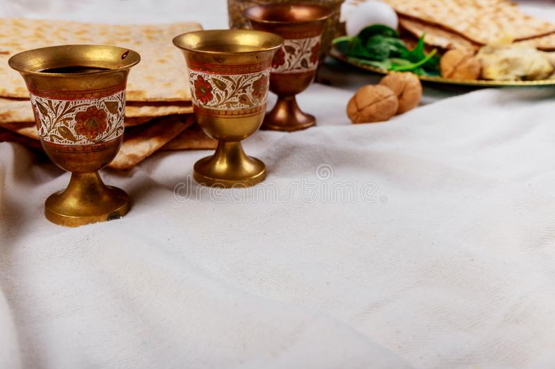 Passover matzoh jewish holiday bread, four glasses kosher wine over table stock photos