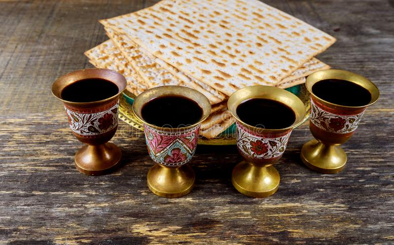 Passover matzoh jewish holiday bread, four glasses kosher wine over wooden table stock photos