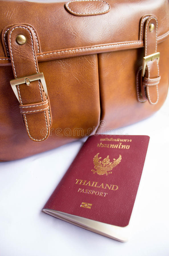 Passport with bag. Thailand passport with vintage bag stock photography