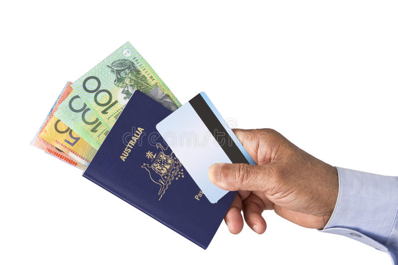 Passport, Bank ATM credit card and Australian dollars. Australian Passport, Australian Dollars, Bank Card, ATM Card, credit card or debit card in hand isolated stock photo