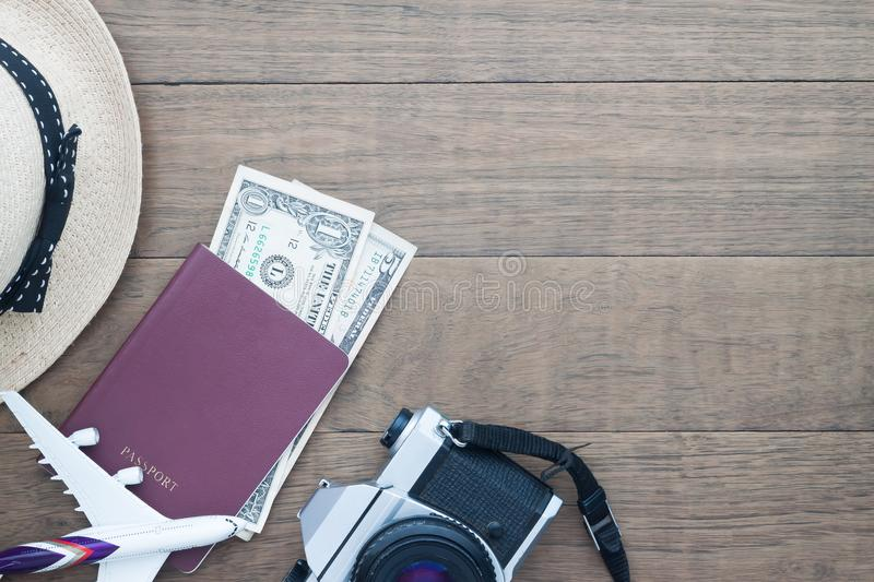 Passport book, money and camera, Travel items on wooden background with copy space, Travel holiday concept royalty free stock image