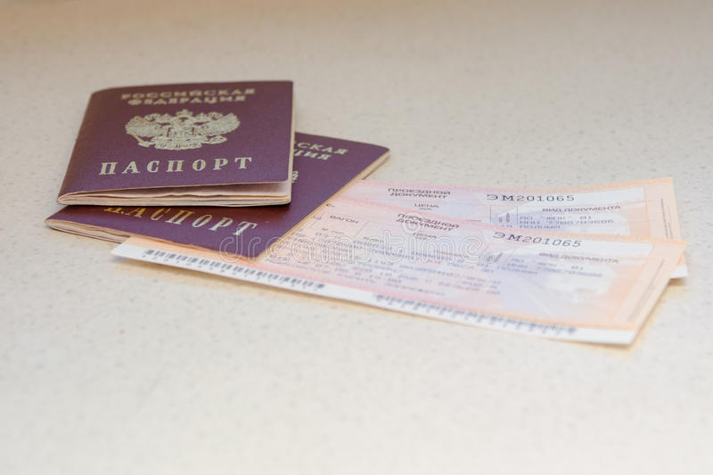 Passport of the citizen of the Russian Federation and train tickets. Volgograd, Russia - August 12, 2015: Passport of the citizen of the Russian Federation and royalty free stock photos