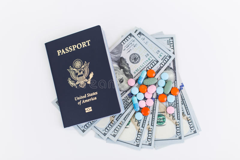 Passport, dollars and pills stock photo