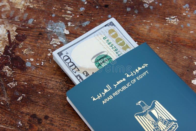Passport of egypt with money. Passport of arabian country egypt with dollar bills money stock photos