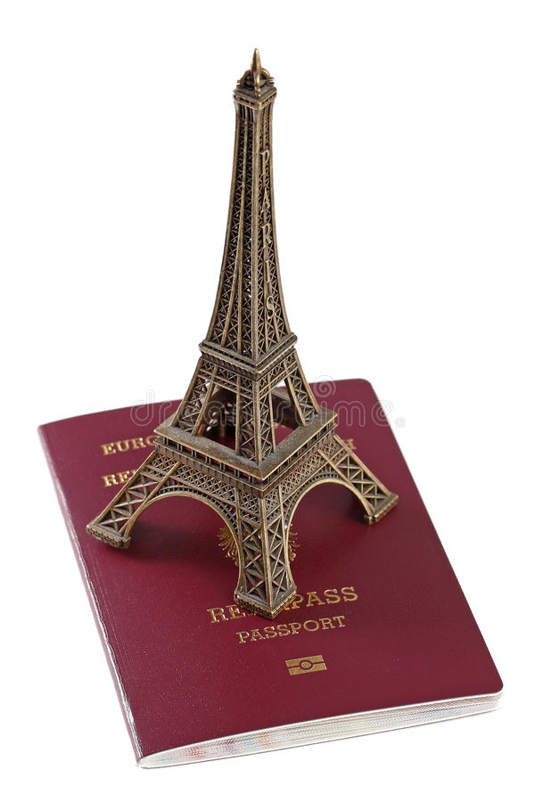 Passport and Eiffel Tower. European Union passport and bronze copy of Eiffel Tower royalty free stock photography