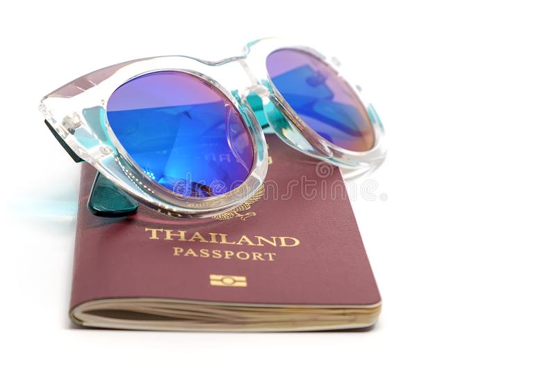 Passport with fashion sunglasses. Fashion sunglasses on Thailand passport on white background for Traveling abroad concept royalty free stock images