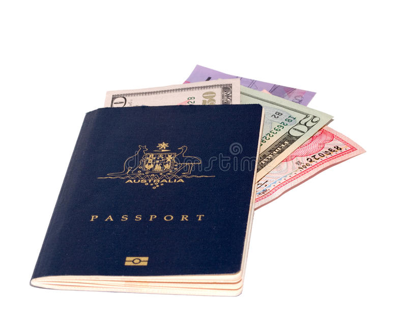 Passport with foreign currency stock photo