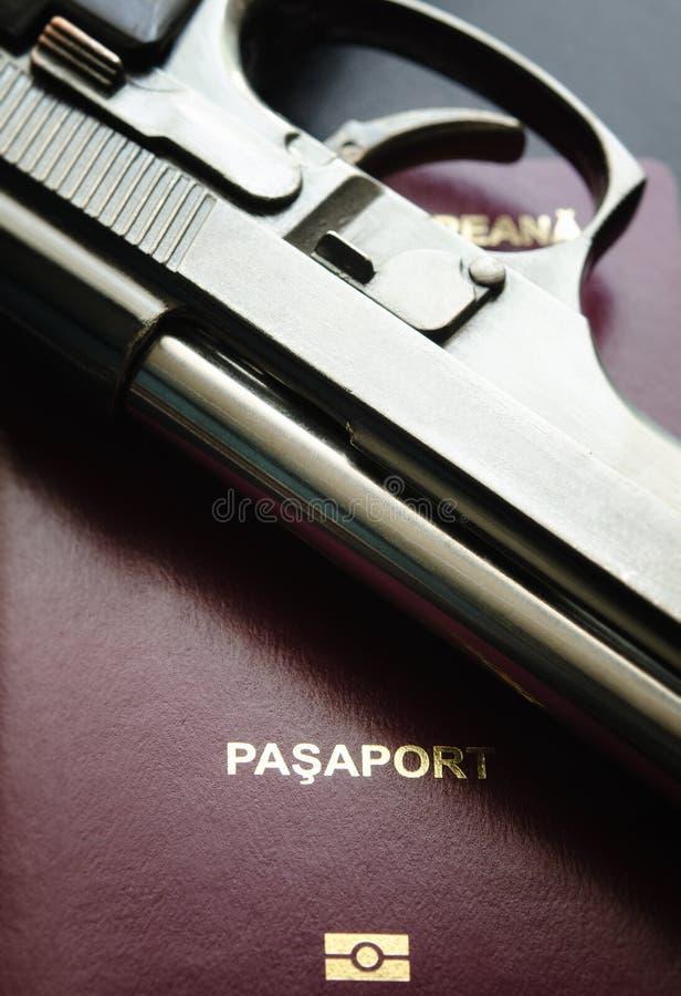 Passport And Gun Royalty Free Stock Photos