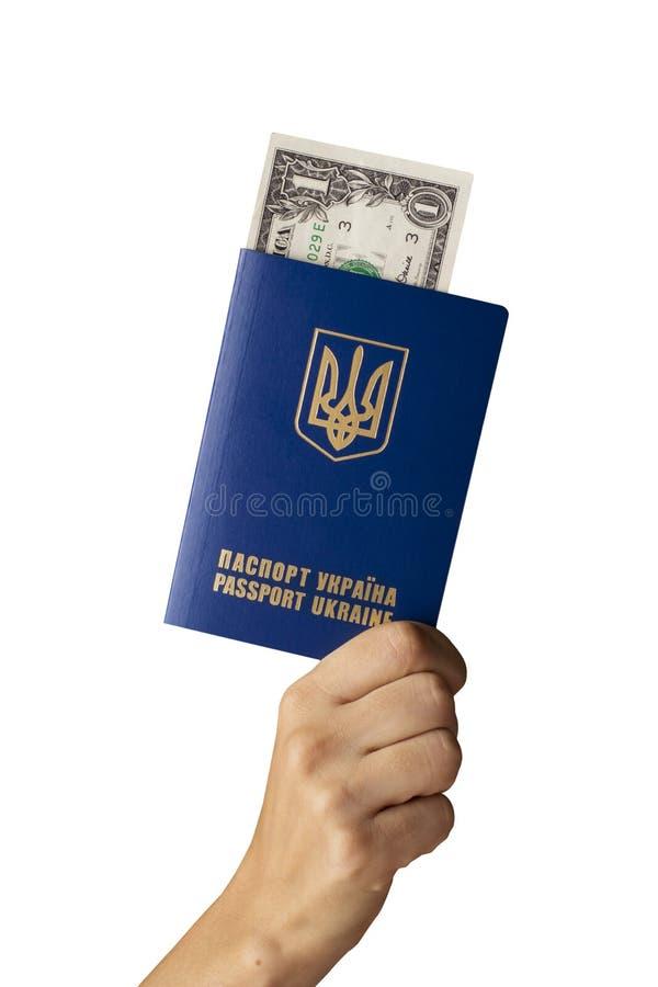 Passport in hand. The Ukrainian international passport and money in hand on a white background stock photography