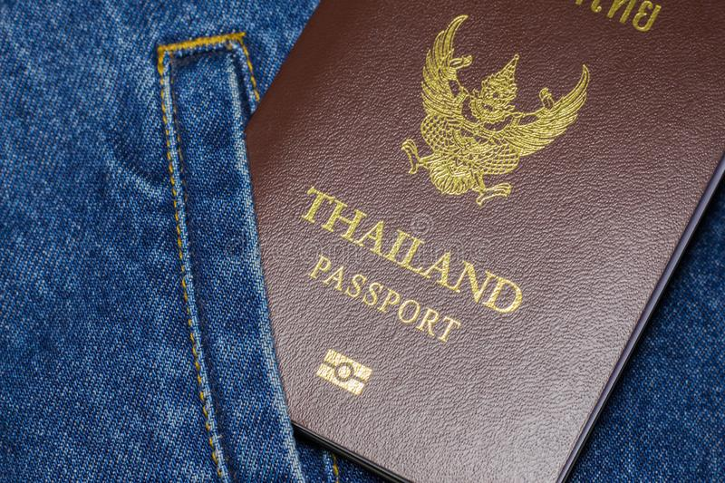 Passport on the jeans. Thailand passport on the shirt pocket of blue jeans stock photos