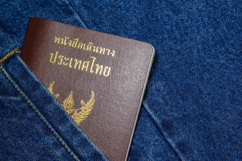 Passport on the jeans. Thailand passport on the shirt pocket of blue jeans royalty free stock images