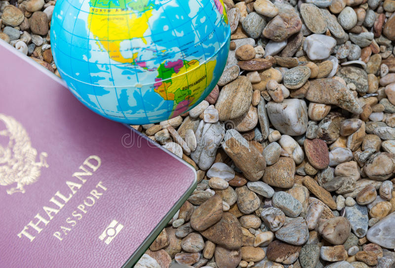 Passport and map. Thailand passport and world map on stone texture background stock images