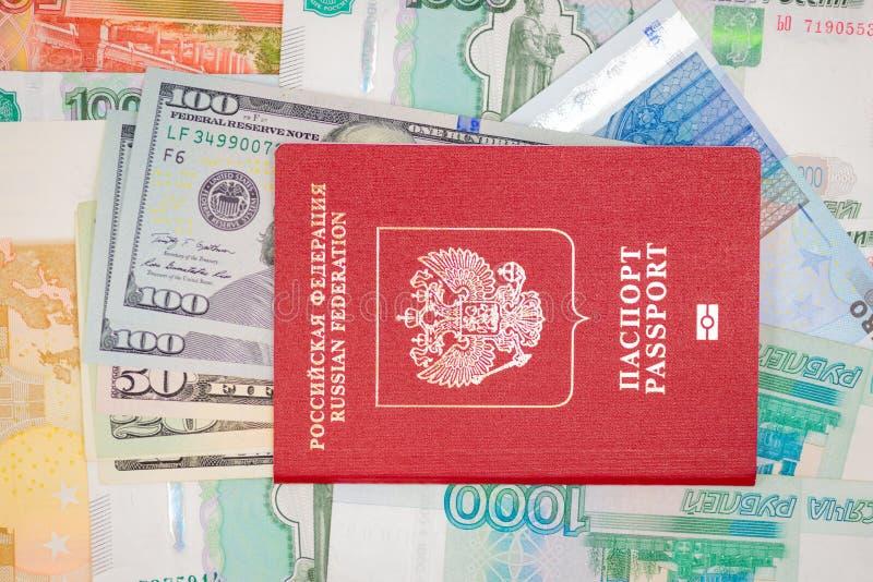 Passport with money dollar euro RUR. Background royalty free stock image