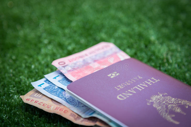 Passport and money. Photo of Thailand passport and money banknote stock photos