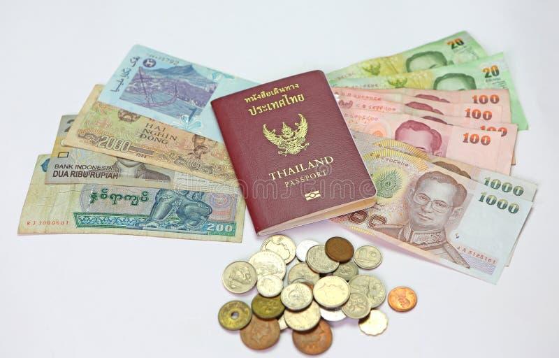 Passport and money. Thailand passport and money savings royalty free stock image