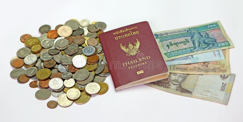 Passport and money. Thailand passport and money savings royalty free stock photography