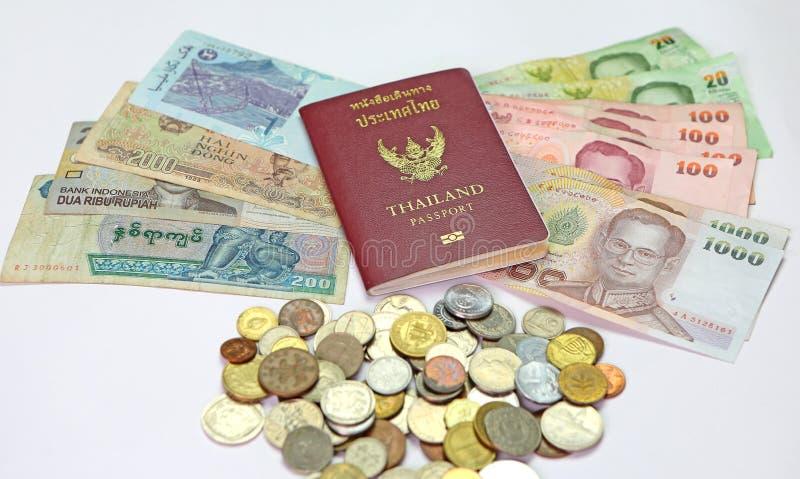 Passport and money. Thailand passport and money savings royalty free stock images