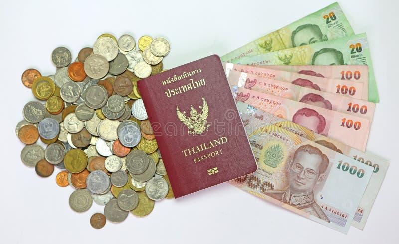 Passport and money. Thailand passport and money savings royalty free stock photo