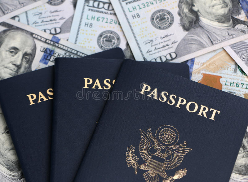 Passport and Money. US passport and hundred dollar bills Travel is expensive stock photography