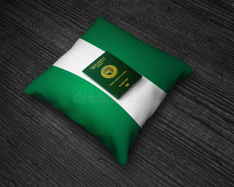 Passport of Nigeria with Nigerian flag pillow. On the top of an wooden backgroud stock photos
