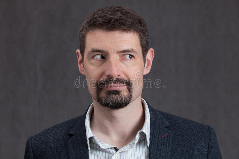 Passport photo of forties man with a goatee beard looking right. An adult male in his early forties with a goatee beard wearing a jacket and shirt. He is smiling royalty free stock photography
