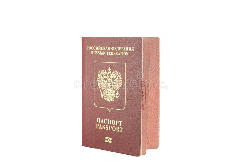 Passport red colour with a Golden eagle emblem stock image