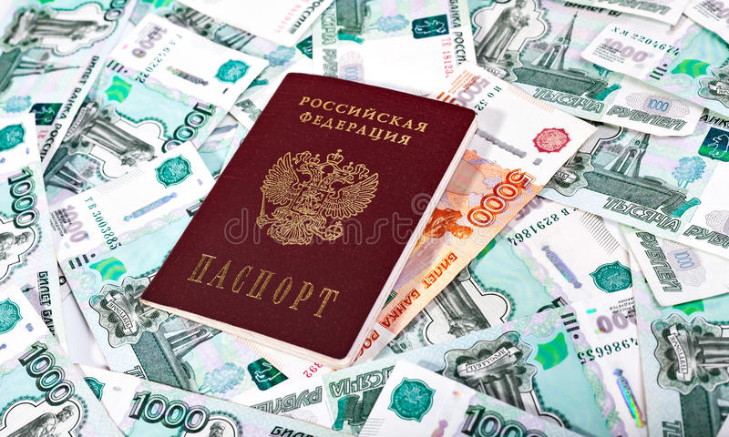 Passport of the Russian Federation and banknotes. Money and Russian banknotes of denomination one and five thousand in the background. Passport of the Russian stock photos