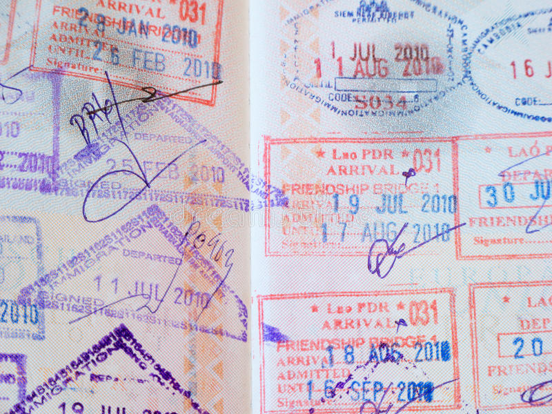 Passport with stamps. Immigration in thailand and laos stock image