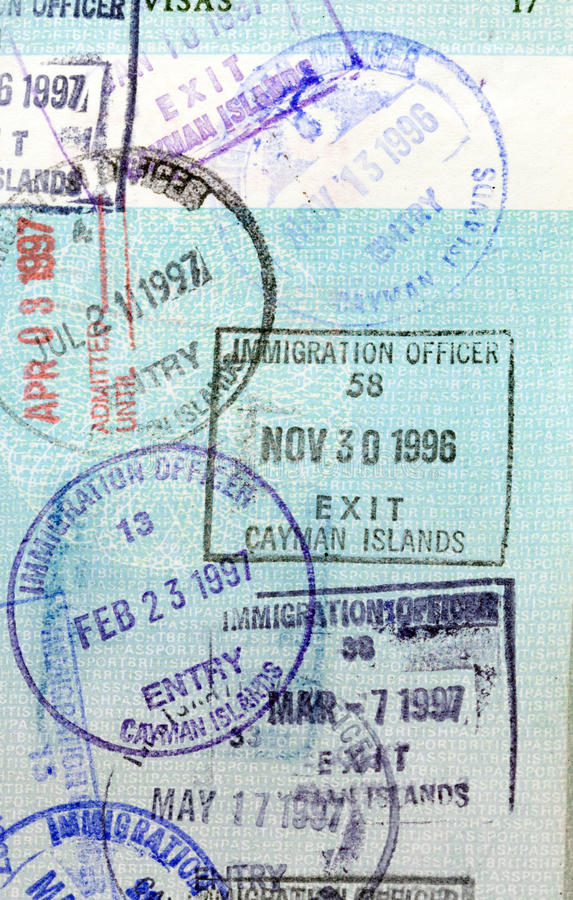 Passport Stamps - Cayman Islands. A British passport with entry and exit stamps for the Cayman Islands, British West Indies royalty free stock photography