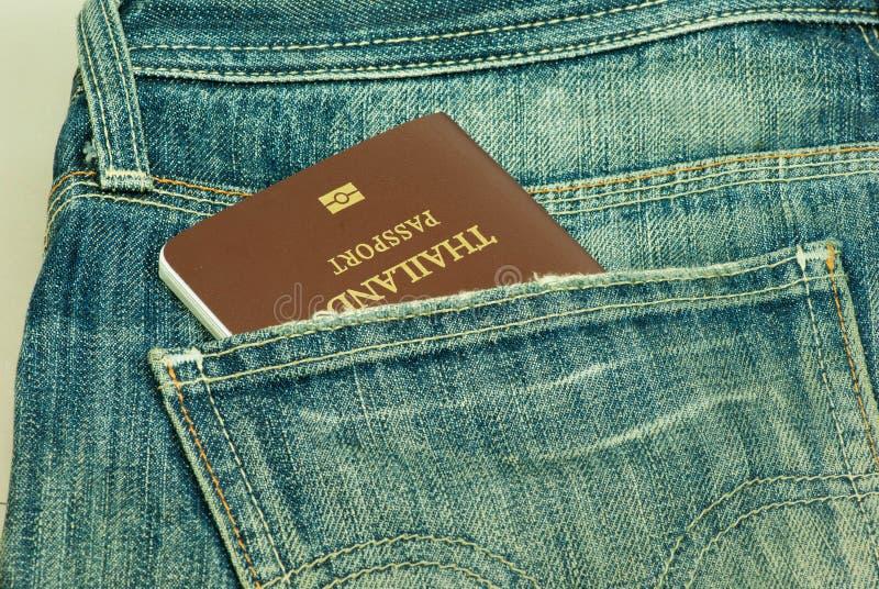 Passport stolen from back pocket Thailand. Back biometric blue border careless carelessness casual close-up closeup control crime criminal customs danger stock photo