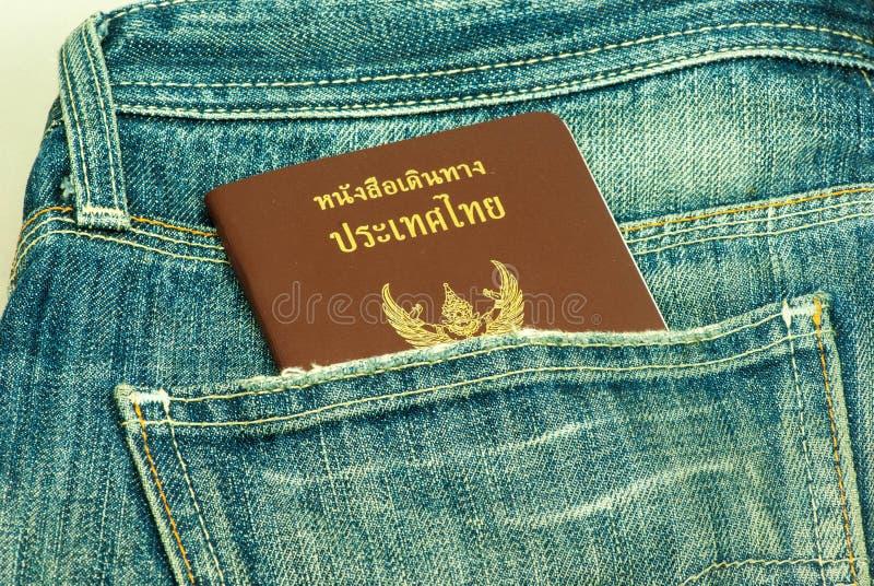 Passport stolen from back pocket Thailand. Back biometric blue border careless carelessness casual close-up closeup control crime criminal customs danger royalty free stock photography