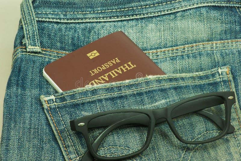 Passport stolen from back pocket Thailand. Back biometric blue border careless carelessness casual close-up closeup control crime criminal customs danger stock photography
