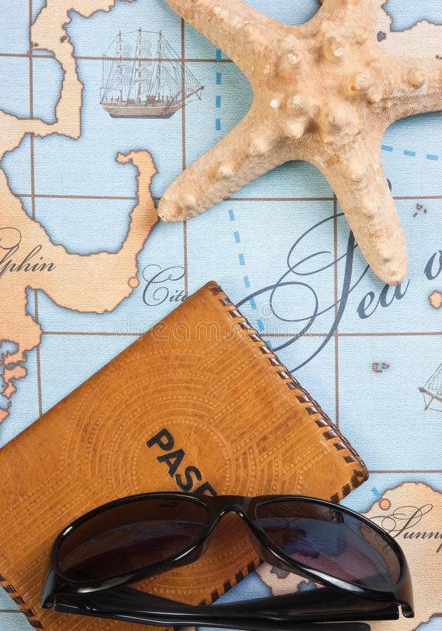 Passport and sunglasses on map royalty free stock photography