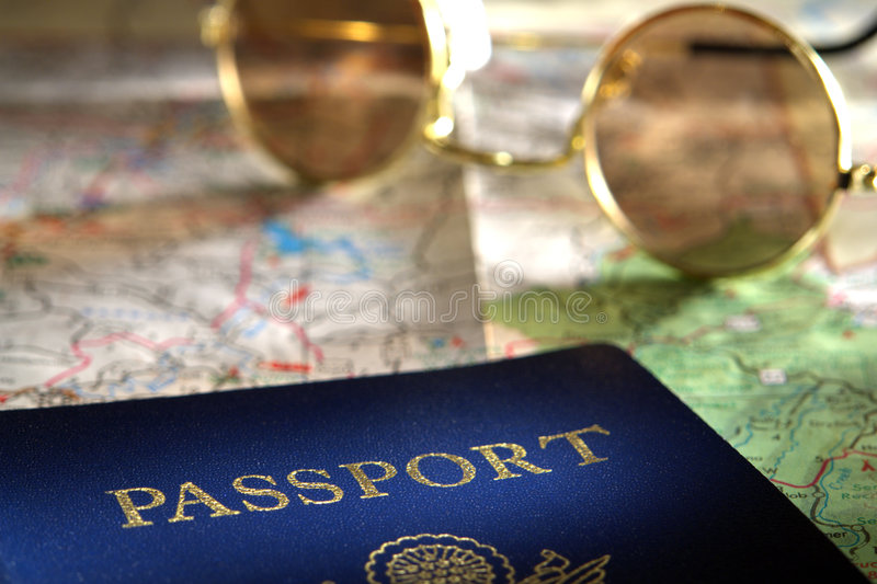 Passport and Sunglasses over Road Travel Map stock photos