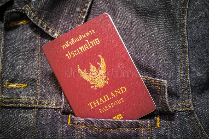 Passport Thailand. In denim shirt stock image
