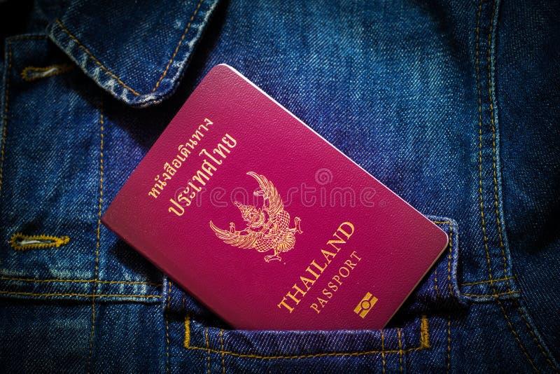 Passport Thailand. In denim shirt royalty free stock photo
