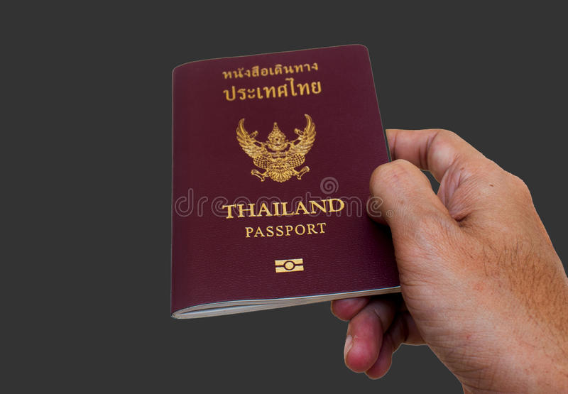 Passport in thailand. Image of a persons hand holding a passport royalty free stock photography