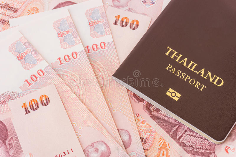 Passport and Thailand's banknotes. Background royalty free stock photo