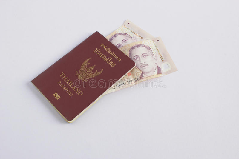 Passport of thailand and Singapore dollar. Passport of thailand and Singapore dollar isolated on white background stock photography