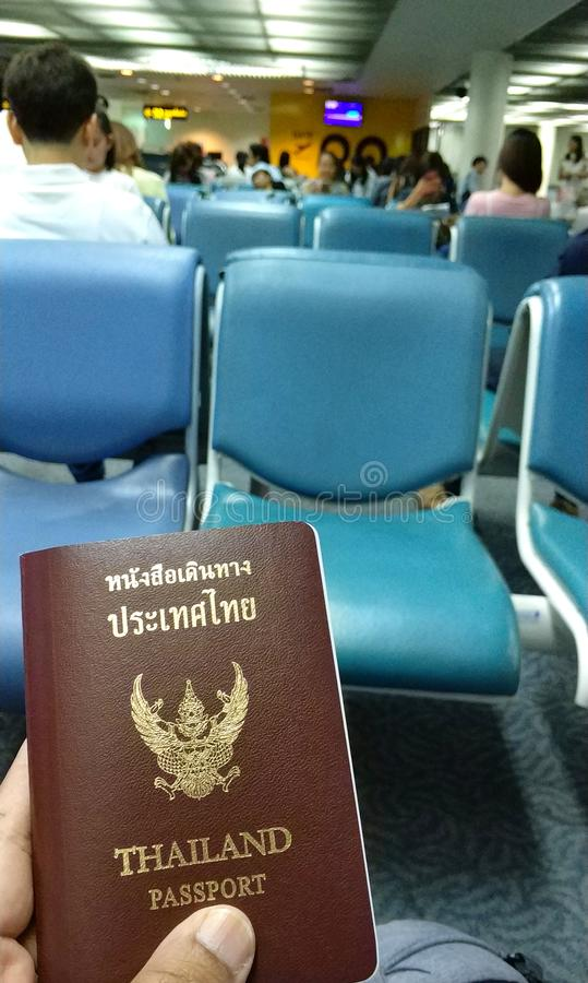 Passport and travel in the airport for departure another country. Traveler was used Thailand passport for travelling to another country. passport is one of stock images