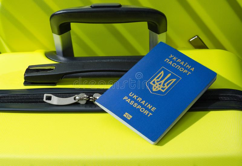 Passport of the traveler.  Suitcase close-up.  At the international airport with a Ukrainian passport.  royalty free stock photo